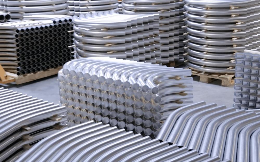 Łuki o dużym promieniu w transporcie pneumatycznym materiałów sypkich